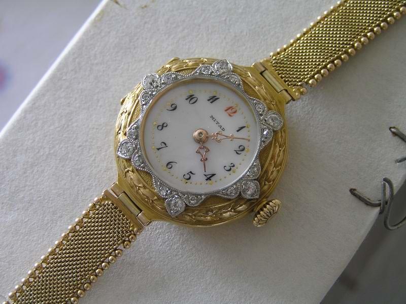 Часы женские брилиантовые золотые